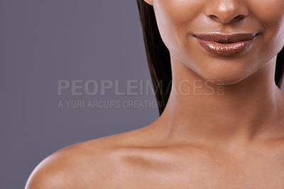 Buy stock photo Cropped shot of a beautiful young woman posing in the studio