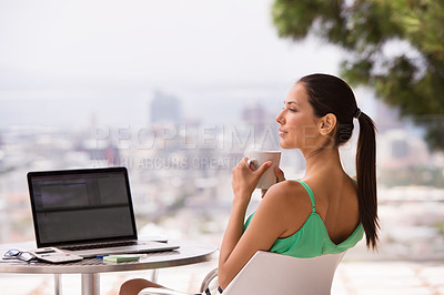 Buy stock photo A cropped shot of a beautiful young woman enjoying a cup of coffee outdoors