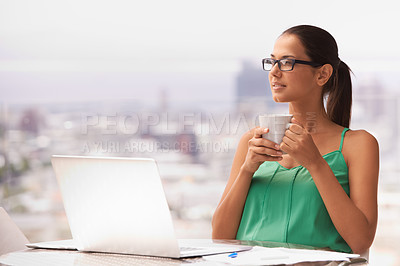 Buy stock photo A beautiful young woman enjoying a cup of coffee while sitting outdoors