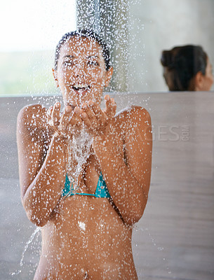 Buy stock photo An attractive young woman showering after a swim