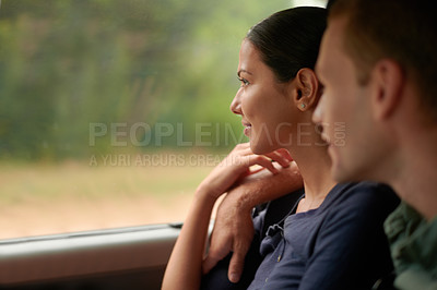 Buy stock photo An attractive couple lookingh out of a car wibndow