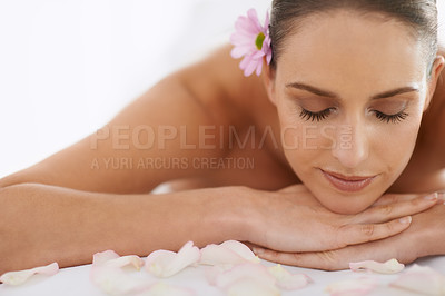 Buy stock photo Closeup of a beautiful young woman lying on a massage table
