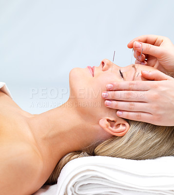 Buy stock photo Portrait of a beautiful woman receiving acupuncture therapy at the day spa - copyspace