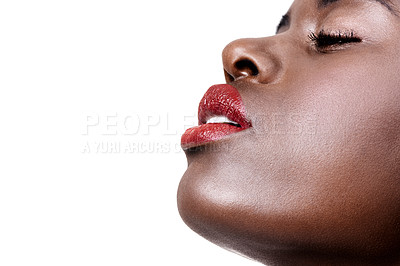 Buy stock photo Studio shot of a beautiful young african woman wearing lipstick isolated on white