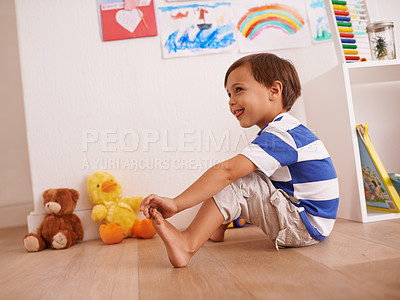 Buy stock photo Shot of a little boy playing in his room