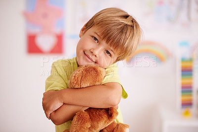 Buy stock photo Portrait of a cute little boy hugging his stuffed animal