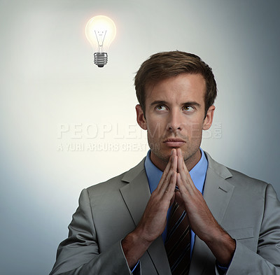 Buy stock photo A young businessman thinking alongside copyspace