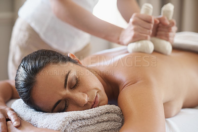 Buy stock photo Shot of an attractive enjoying a massage with hot compresses