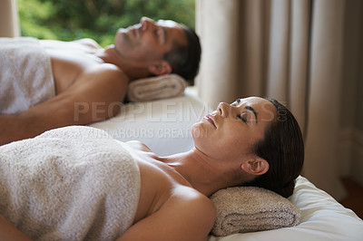 Buy stock photo Shot of a mature couple relaxing on their massage tables