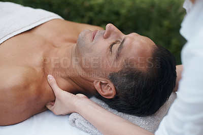 Buy stock photo Cropped shot of a handsome man enjoying a massage