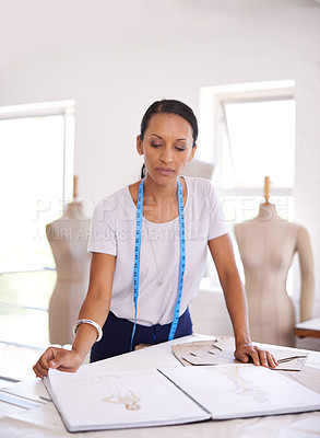 Buy stock photo Shot of an attractive seamstress at work in her boutique