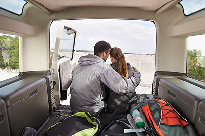 Buy stock photo Cropped shot of a young couple at the back of their car while on a roadtrip