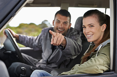 Buy stock photo Cropped shot of a young couple on a roadtrip