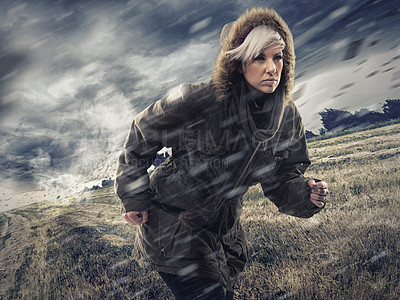 Buy stock photo Cropped shot of an attractive young woman running with pace through stormy weather