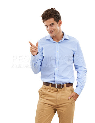Buy stock photo Portrait of a handsome young man in a studio pointing up with one hand