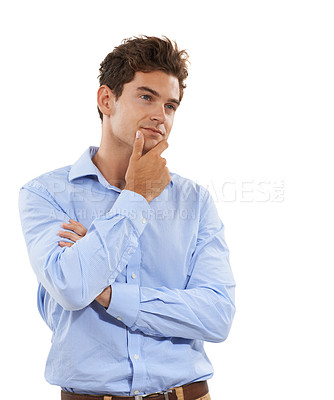 Buy stock photo Shot of a handsome young man looking thoughtful in a studio