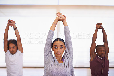 Buy stock photo Shot of a group of young dancers stretching together in a studio