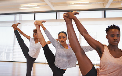 Buy stock photo Shot of a group of young dancers rehearsing together in a studio