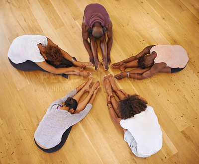 Buy stock photo High angle shot of a young group of dancers stretching on the floor