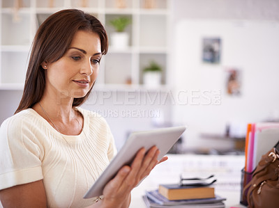Buy stock photo A beautiful young businesswoman holding a tablet