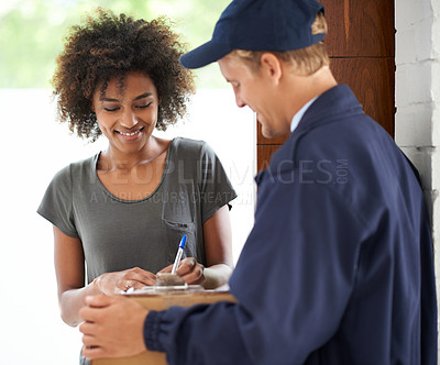 Buy stock photo Shot of a courier making a delivery to a smiling customer