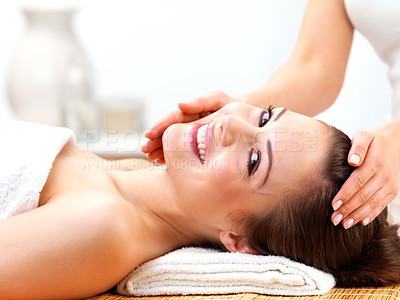 Buy stock photo Portrait of a cheerful young female receiving facial massage