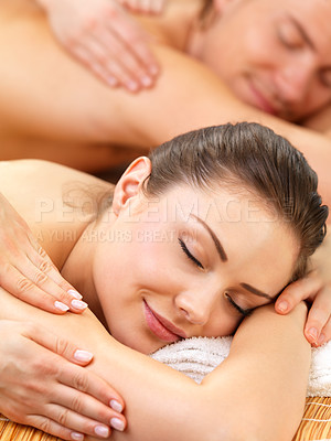 Buy stock photo Close up portrait of a relaxed couple, on a spa holiday, enjoying back massages