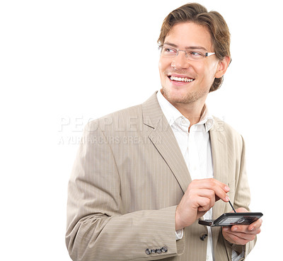 Buy stock photo Cheerful businessman holding cellphone and looking away