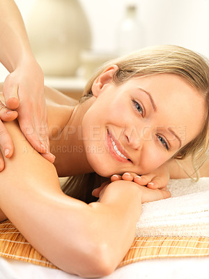 Buy stock photo Hands massaging a young female at the day spa - Cheerful woman receiving a shoulder massage