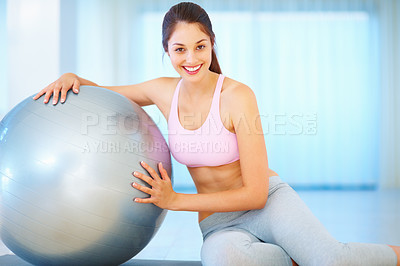 Buy stock photo Portrait of young girl leaning on pilates ball and giving you an attractive smile