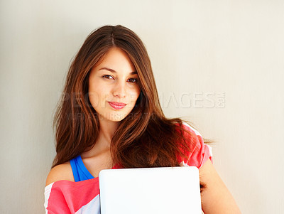 Buy stock photo Portrait of cute young girl holding laptop and giving you warm smile