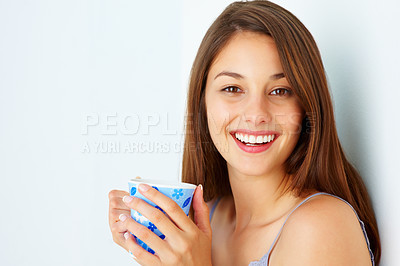 Buy stock photo Closeup of cute young woman holding cup of coffee and smiling on white background