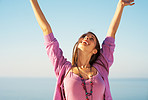 Joyful woman with arms in the air