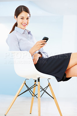 Buy stock photo Portrait of cute business woman sitting on chair using mobile phone