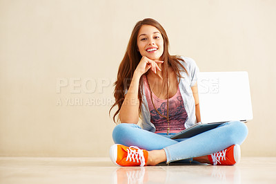 Buy stock photo Full length of beautiful young woman sitting with laptop and giving you cute smile