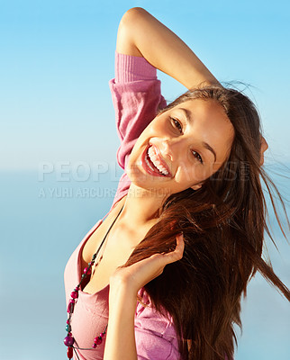 Buy stock photo Portrait of beautiful young woman having good time outdoors