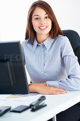 Buy stock photo Portrait of businesswoman sitting at table and giving you an attractive smile