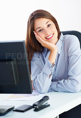Buy stock photo Portrait of cute female executive sitting at office table and smiling