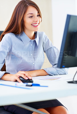 Buy stock photo Portrait of an attractive young female executive working on office computer