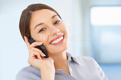 Buy stock photo Closeup of business woman talking on cellphone and giving you cute smile