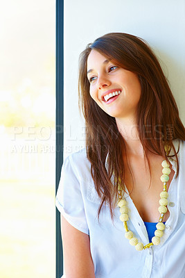 Buy stock photo Beautiful young woman looking away and smiling