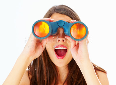 Buy stock photo Closeup of surprised young woman looking through binoculars