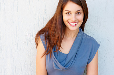 Buy stock photo Attractive young woman standing against wall - copyspace