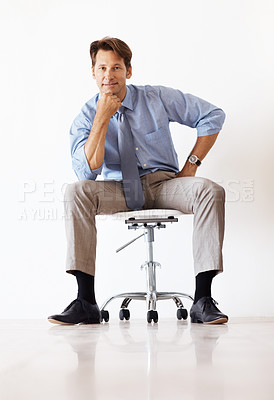 Buy stock photo Portrait of a smart young businessman sitting on the chair