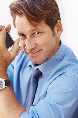 Buy stock photo Portrait of a handsome young male executive holding mobile phone