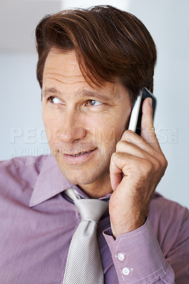 Buy stock photo Closeup portrait of a smart young male entrepreneur speaking on mobile phone