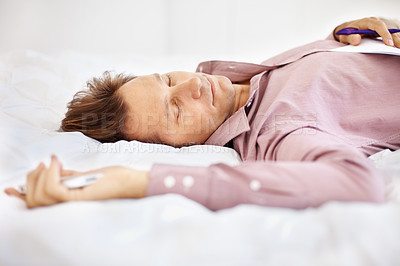 Buy stock photo Portrait of a tired Businessman sleeping with mobile phone in hand