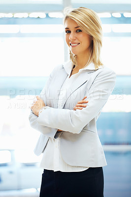 Buy stock photo Portrait of pretty woman standing with arms folded