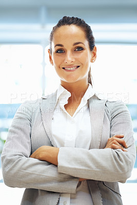 Buy stock photo Pretty woman standing and smiling with arms folded
