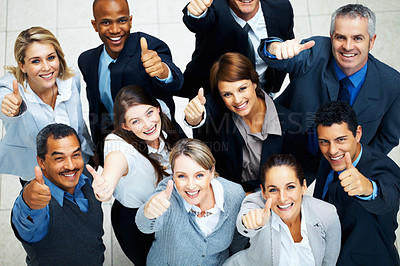 Buy stock photo High angle view of group of executives giving thumbs up